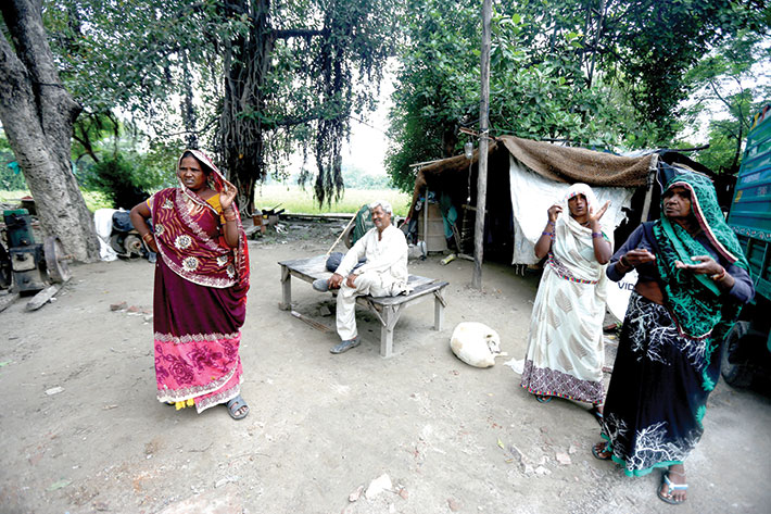 After the DDA razed their homes, farmers and their families live in temporary shelters.
