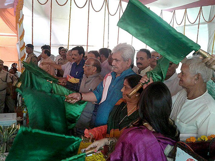 Manoj Sinha, minister of state for railways, flagging off the train