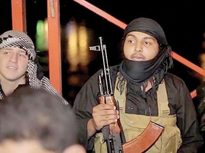 A screen shot of the video released by the group's media wing shows Abdullah Elmir (left) sitting with a fellow Islamic State fighter