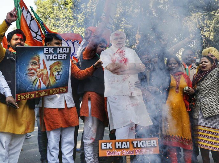 BJP workers celebrate at party headquarters in New Delhi (Photo: Arun Kumar)