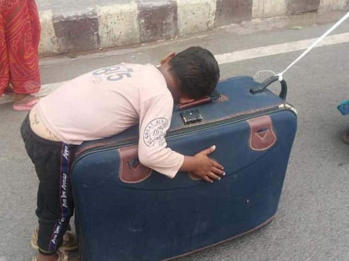 Migrant mother pulls suitcase with child asleep on it: NHRC takes note