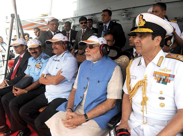 PM Modi witnessing an air-and-naval show aboard INS Vikramaditya, on December 15, 2015, after attending the annual Combined Commanders Conference – held on board an aircraft carrier for the first time