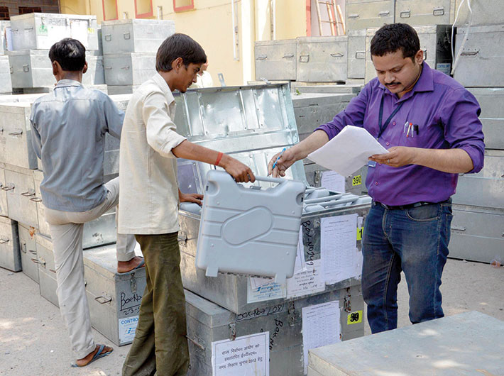 A polling official cheks and tallies the EVMs. Representational photo