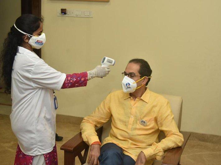 A BMC health survey team member visiting Maharashtra chief minister Uddhav Thackeray as part of the 'My Family My Responsibility' campaign. (Photo courtesy: BMC)