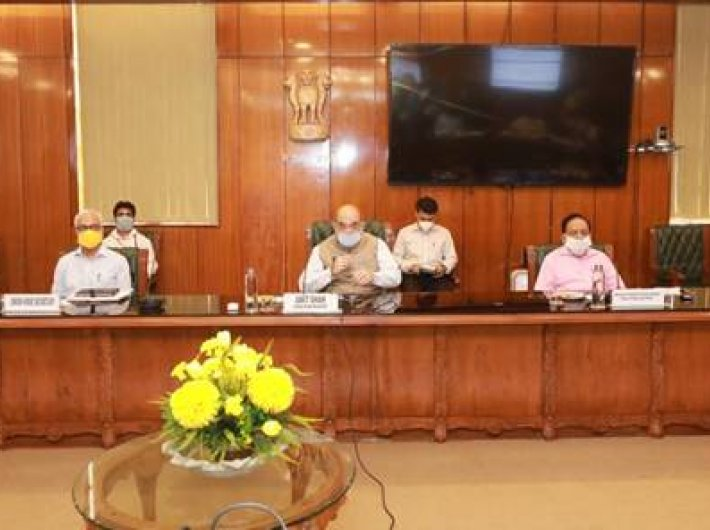 Home minister Amit Shah and others at the meeting to review the capital`s Covid-19 situation Sunday.