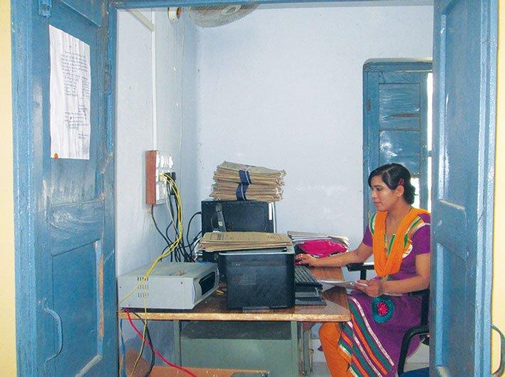 A woman at Bhitaura block office, Fatehpur, feeding data of PMAY applicants into the computer