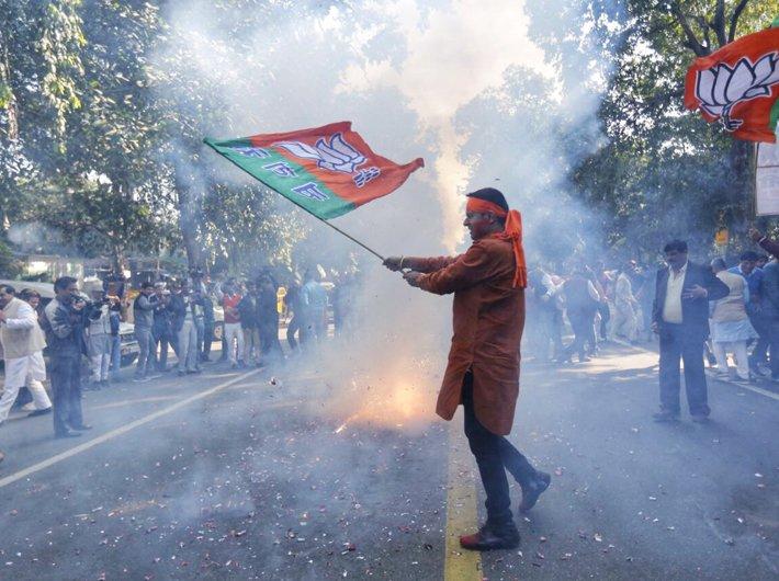 In pictures: Celebrations begin as BJP retain power in Gujarat, wins Himachal