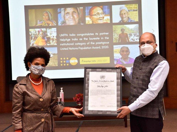 Argentina Matavel Piccin, Representative India, UNFPA, presents the UN Population Award certificate to Rohit Prasad, CEO, HelpAge India