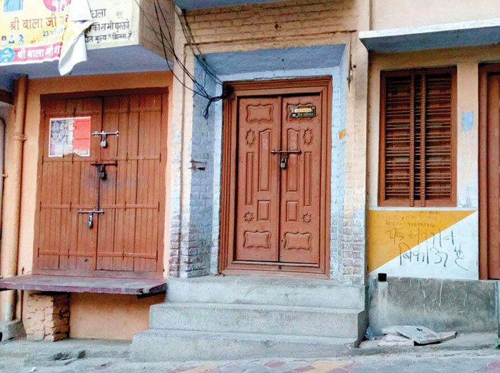 'House for sale' sign painted on a house in Kairana