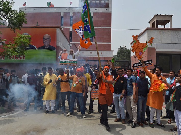 BJP supporter celebrating Karnataka assembly results in Delhi. Photo: Arun Kumar