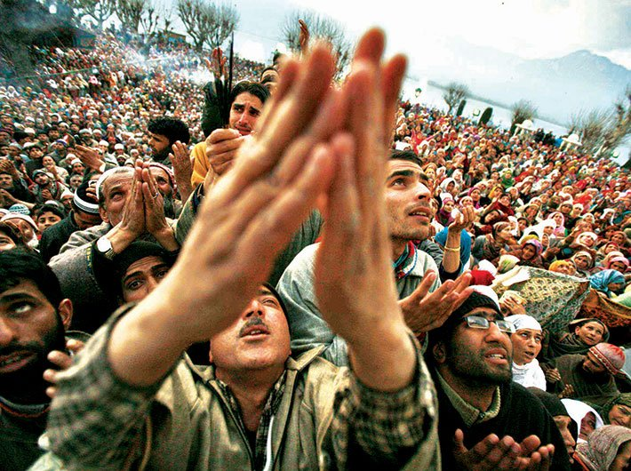 People go into raptures as they get a glimpse of the relic at the Hazratbal shrine