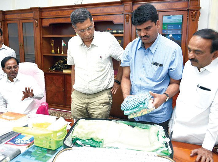 Chief minister KCR and GoI's economic advisor Arvind Subramanian take a look at a sample kit (Photo: Twitter/KCR)
