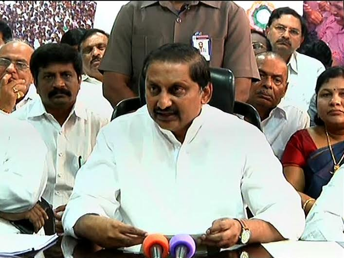 Kiran Kumar Reddy addresses the media with several cabinet colleagues and fellow legislators in Hyderabad on Wednesday afternoon after resigning as the Andhra Pradesh CM.
