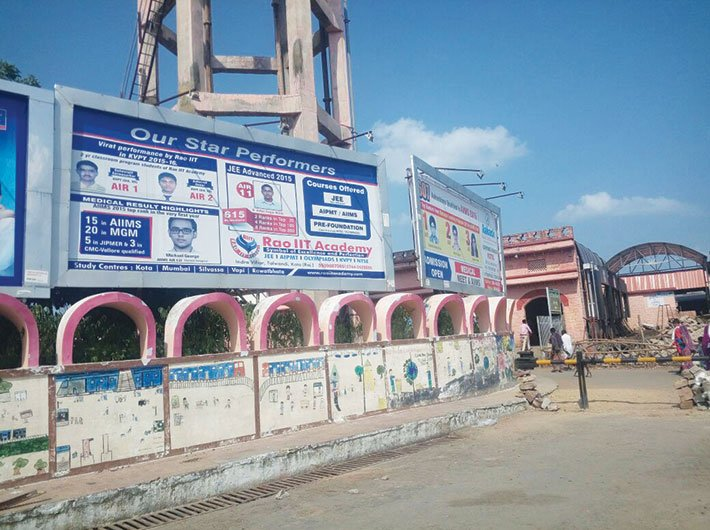 Coaching institutes put up their hoardings on the boundary wall of Kota station