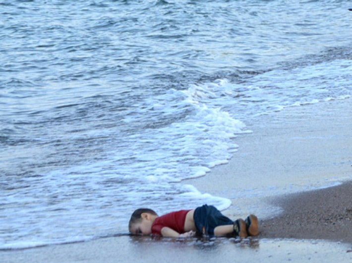 Image result for 3-year-old's lifeless body that swept ashore on a Turkish beach