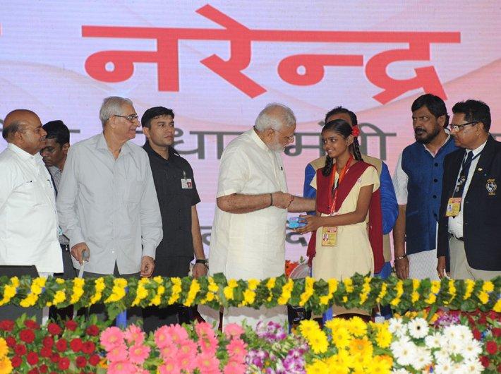 Narendra Modi with a physically challenged, or Divyang student, at Samajik Adhikarita Shivir, in Navsari, Gujarat on Saturday