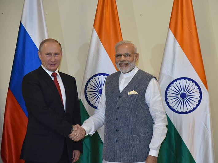 PM Narendra Modi with the Russian president Vladimir Putin ahead of the restricted talks between the two nations, in Goa on October 15