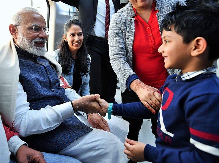 Prime minister Narendra Modi takes metro to attend the Gita Aradhana Mahotsav, at ISKCON Temple, in New Delhi on February 26