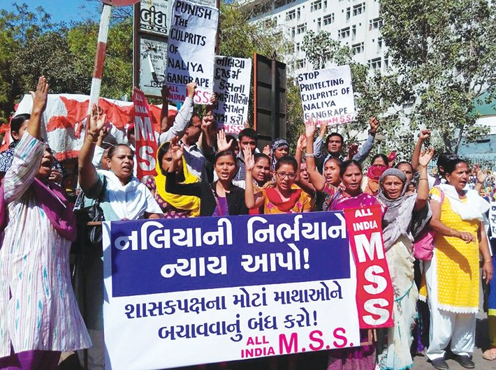 Members of women organisations protest in Ahmedabad for a fair probe in the Naliya case