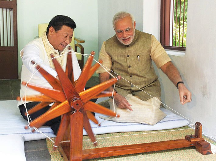 Narendra Modi shows Xi Jinping how to work the spinning wheel at the Sabarmati Ashram in Ahmedabad during the Chinese president`s recent visit to India.