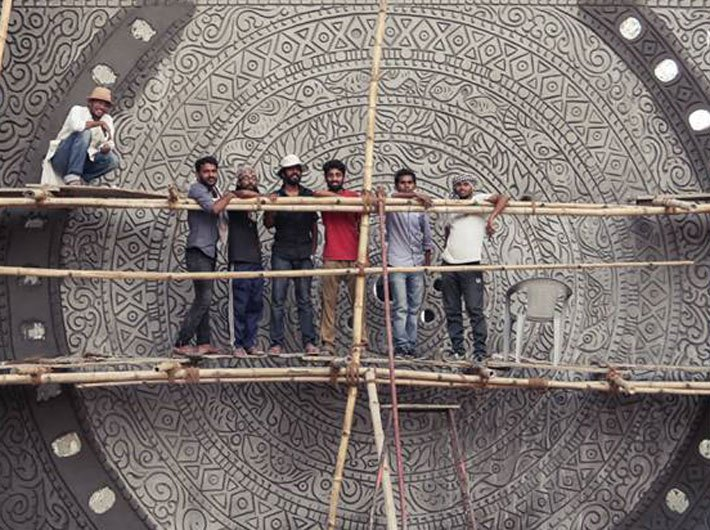 Suresh Nair and his team working on a mural in Varanasi
