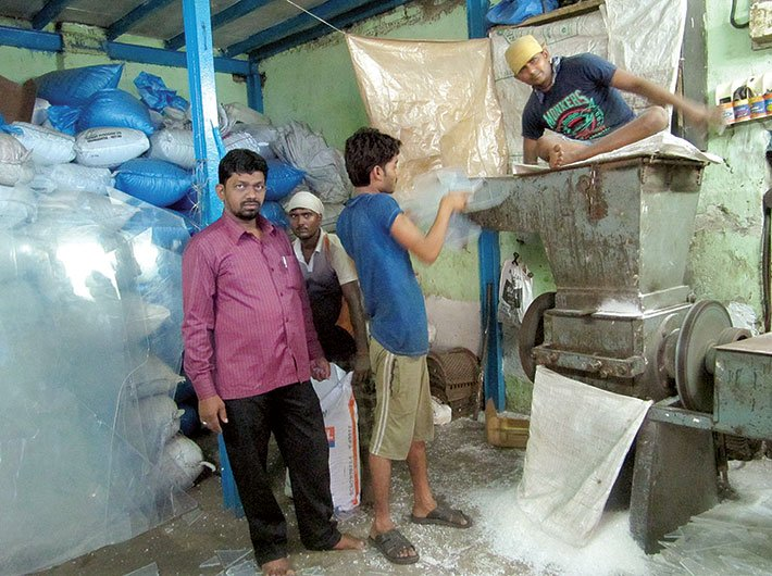 Khwaja Qureshi at his plastic recycling unit in Dharavi, Mumbai