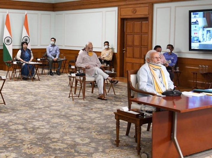 PM Modi with home minister Amit Shah and health minister Dr Harsh Vardhan during the video conferencing with the chief ministers on Monday.