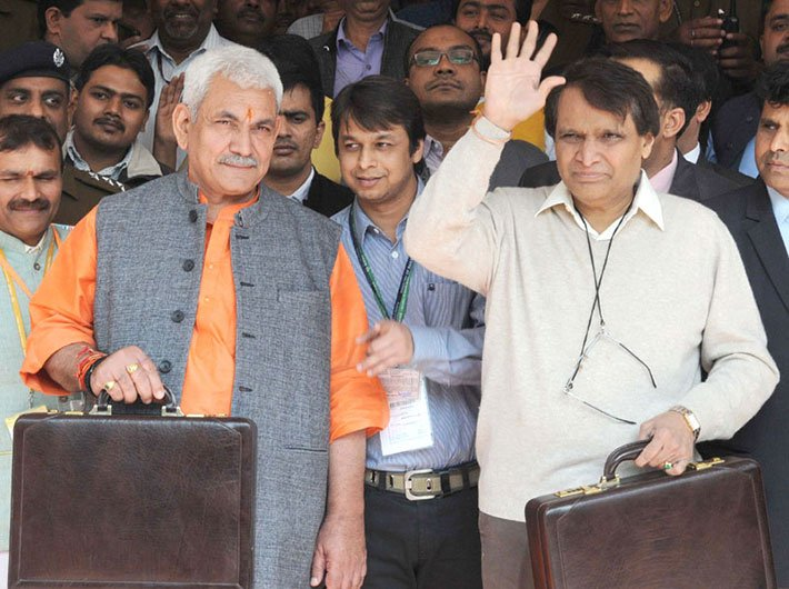 Union minister for railways, Suresh Prabhu, and minister of state for railways, Manoj Sinha, leaving Rail Bhawan for Parliament House to present the Railway Budget 2016-17.