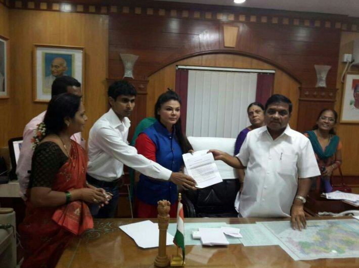 Rakhi Sawant at Maharashtra home minister RR Patil`s (right) office.