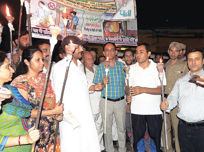 Ravinder Kumar, with others, on a torch rally to spread awareness against open defecation (Photo: Ravinder Kumar)