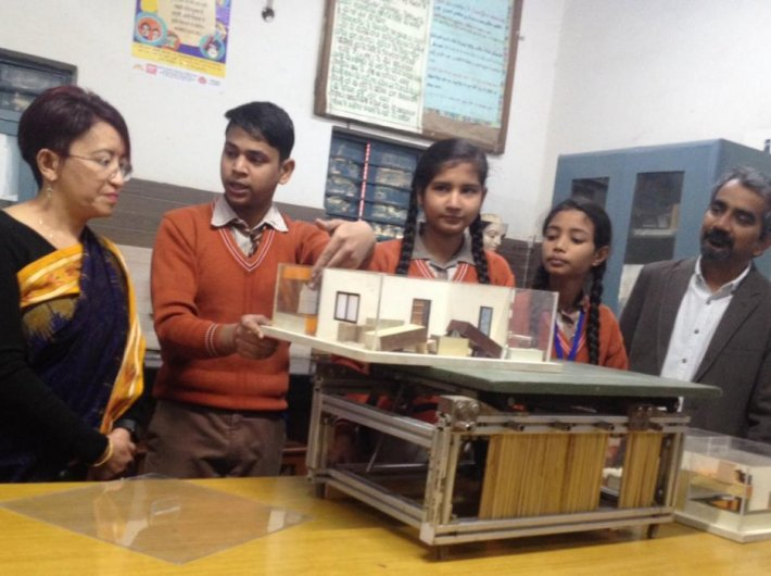Students demonstrate the importance of fixing down loose elements in a building, with Sangita Ghalay of Honeywell India and Dr Anshu Sharma of SEEDS (GN Photo)
