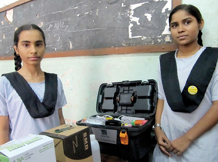 Bushra (right) with her mobile phone repairing kit. (Photos: Geetanjali Minhas)