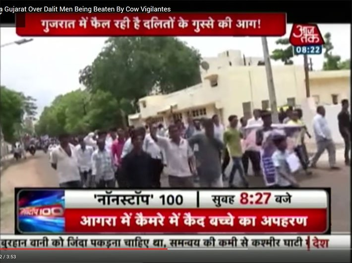 A TV grab of Aaj Tak showing protest by dalits in Gujarat