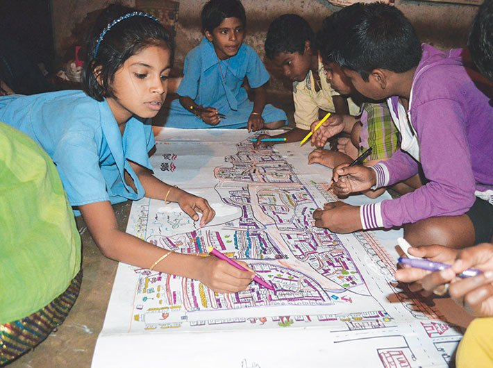 Armed with colour pens and crayons, the children have created maps of their slums