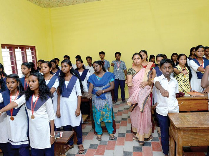 Student volunteers for palliative care take oath before they join the local dispensary on home visits of bed ridden patients
