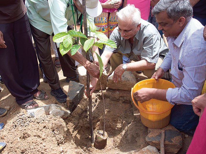 Sri M planting a sapling for the My Tree initiative