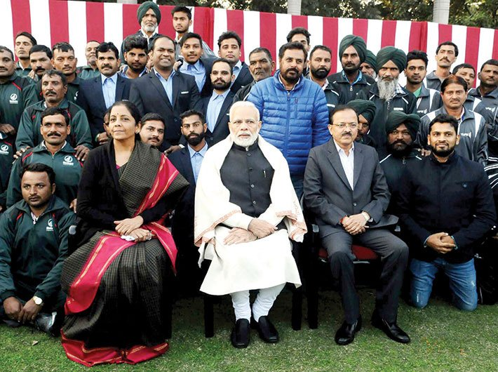 Defence minister Nirmala Sitharaman and PM Narendra Modi with NCC cadets, NSS volunteers, tableaux artists and tribal guests, in New Delhi in January