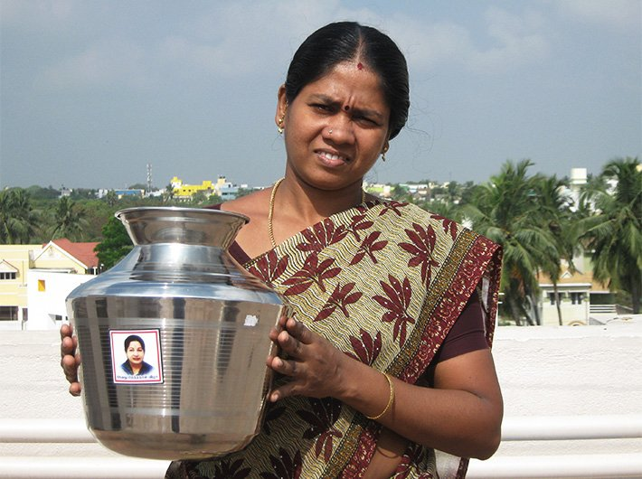 Vaani showing her steel water container with Jayalalithaa`s picture on it.
