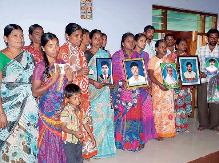 Families of farmers who committed suicide, at Warangal district headquarters.