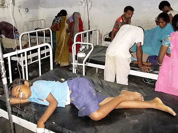 Schoolchildren being treated at a hospital after they fell ill following midday meal at a village in Chapra district of Bihar on Tuesday.