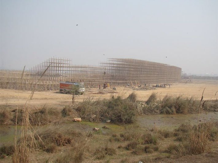 Construction work in progress at the Yamuna bed