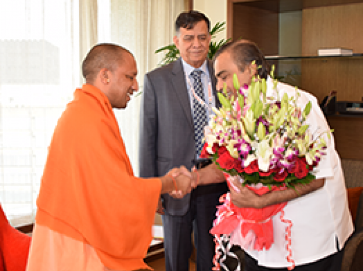 Uttar Pradesh CM with Mukesh Ambani of the Reliance group